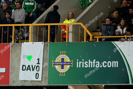 A banner in the crowd celebrating the 100th cap of Steven Davies
