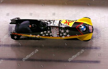 Nick Cunningham and Ryan Bailey, of the United States, round a curve at the World Cup bobsled opener in Lake Placid, N.Y., . The two placed second in the event