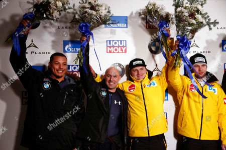 Nico Walther, right, and Christian Poser, of Germany, pose after placing first at the World Cup bobsled opener in Lake Placid, N.Y., . Nick Cunningham, second from left, and Ryan Bailey, of the United States, placed second