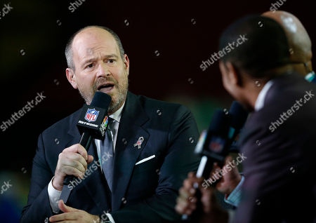 NFL Network host Rich Eisen speaks Thursday Night Football host Tony Dungy speaks during their broadcast during half time of an NFL football game between the Seattle Seahawks and the Arizona Cardinals, in Glendale, Ariz
