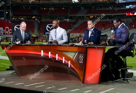 NFL Network Thursday Night Football hosts from left, Rich Eisen, Terrell Davis, Steve Mariucci, and Michel Irvin talk during their broadcast after an NFL football game between the Seattle Seahawks and the Arizona Cardinals, in Glendale, Ariz