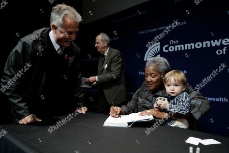"""Donna Brazile, Kai Coffman Marvin. Former Democratic National Committee chair Donna Brazile, at right, signs copies of her book """"Hacks"""", holding her 17-month old godson Kai Coffman Marvin, after Brazile spoke at The Commonwealth Club, in San Francisco"""
