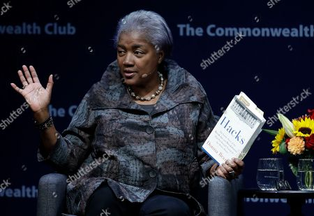 """Former Democratic National Committee chair Donna Brazile holds a copy of her book """"Hacks"""", detailing the hacking of the DNC, during a meeting of The Commonwealth Club, in San Francisco"""