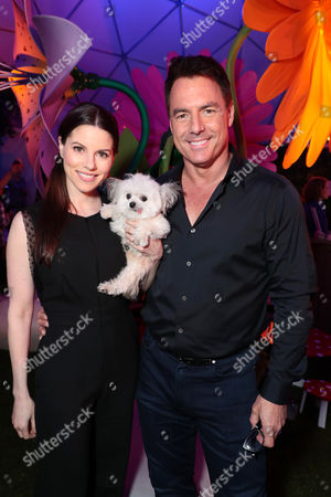 Stock Image of Julie Steines, Mark Steines and Norbert The Dog