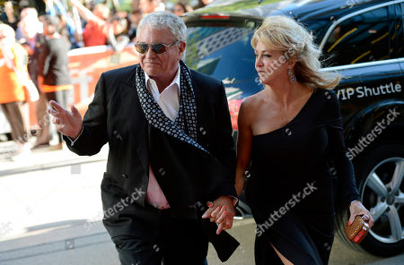 "Stock Image of Tom Berenger, a cast member in the 1983 film ""The Big Chill,"" arrives with his wife Laura at a reunion screening of the film at the 2013 Toronto International Film Festival at The Princess of Wales Theatre on in Toronto"