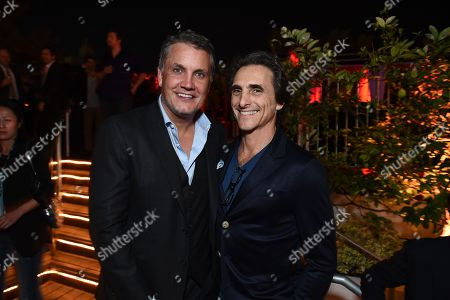 Stuart Ford, CEO of IM Global, left, and producer Lawrence Bender are seen at the 2014 American Film Market (AFM) at the Loews Santa Monica Hotel on in Santa Monica, Calif