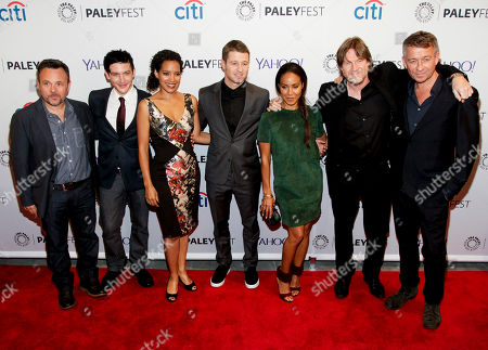 """Danny Cannon, from left, Robin Lord Taylor, Zabryna Guevara, Benjamin McKenzie, Jada Pinkett Smith, Donal Logue and Sean Pertwee attend the PaleyFest New York """"Gotham"""" panel discussion during The William S. Paley Television Festival at The Paley Center for Media, in New York"""