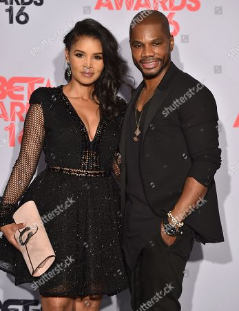 Tammy Collins, left, and Kirk Franklin, winner of the award for Dr. Bobby Jones best gospel/inspirational award, pose in the press room at the BET Awards at the Microsoft Theater, in Los Angeles