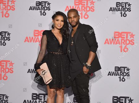 Kirk Franklin, right, winner for the award for Dr. Bobby Jones best gospel/inspirational, and Tammy Collins pose in the press room at the BET Awards at the Microsoft Theater, in Los Angeles