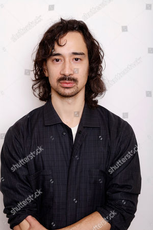 """Writer and director Jason Lew poses for a portrait to promote the film, """"The Free World"""", at the Toyota Mirai Music Lodge during the Sundance Film Festival on in Park City, Utah"""