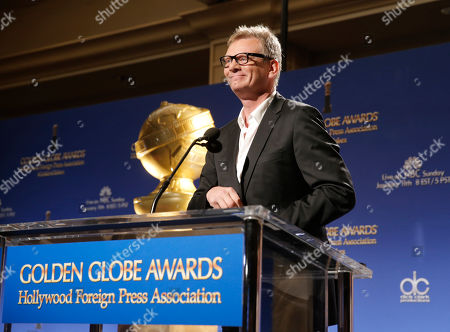 Stock Photo of HFPA President Theo Kingma speaks at the 72nd annual Golden Globe Awards nominations announcement at the Beverly Hilton hotel, in Beverly Hills, Calif. The 72nd annual Golden Globe Awards will be held on Sunday, Jan. 11, 2015