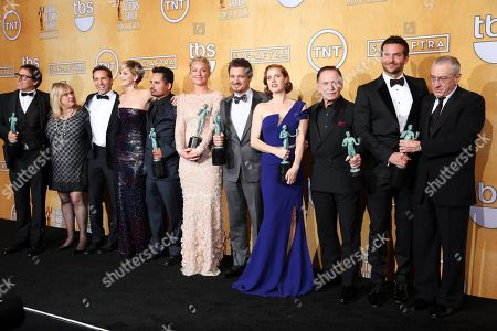 From left, David O. Russell, Colleen Camp, Alessandro Nivola, Jennifer Lawrence, Michael Pena, Elisabeth Rohm, Jeremy Renner, Amy Adams, Paul Herman, Bradley Cooper and Robert De Niro pose in the press room with the award for outstanding performance by a cast in a motion picture for â?œAmerican Hustleâ?? at the 20th annual Screen Actors Guild Awards at the Shrine Auditorium, in Los Angeles