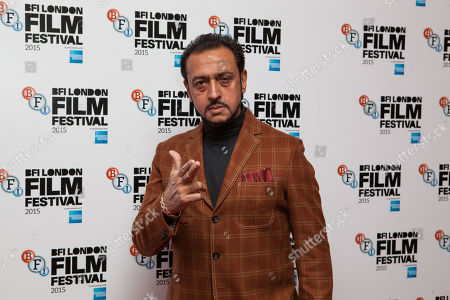 Actor Gulshan Grover poses for photographers upon arrival at the Premiere of the film Beeba Boys, showing as part of the London Film Festival, in central London