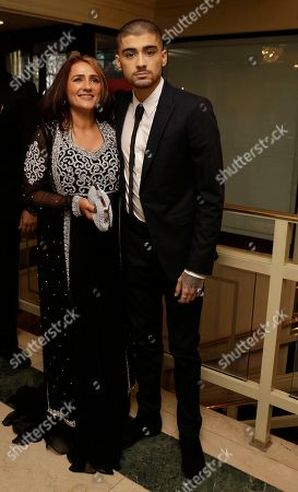Zayn Malik, right, poses with his mother Trisha Malik, for photographers upon arrival at The Asian Awards in central London, Friday, 17 April, 2015