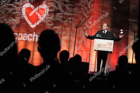 Nestor Serrano speaks onstage at the CoachArt Gala of Champions held at The Beverly Hilton, in Beverly Hills, Calif