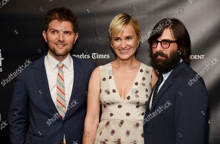"""Adam Scott, left, Judith Godreche, center, and Jason Schwartzman, cast members in """"The Overnight,"""" pose together at the premiere of the film at the Los Angeles Film Festival, in Los Angeles"""