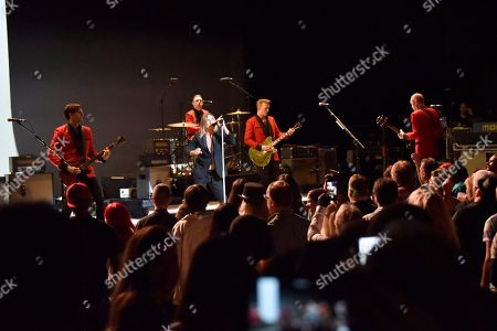 Dean Fertita, from left, Matt Helders, Iggy Pop, Josh Homme and Matt Sweeney perform during the Post Pop Depression tour at the Filmore, in Miami Beach, Fla