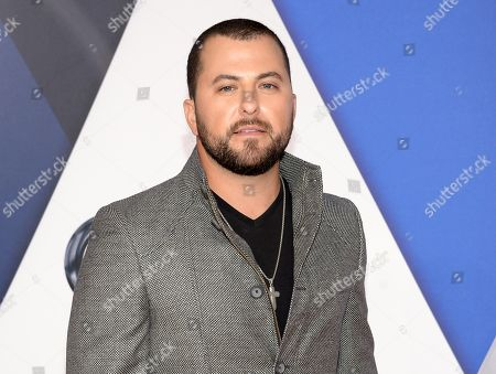 Tyler Farr arrives at the 49th annual CMA Awards at the Bridgestone Arena in Nashville, Tenn. Farr is cancelling upcoming shows to rest his voice after having surgery to remove a polyp on his vocal chords. In a statement released, from his label, the â?oeRedneck Crazyâ?? singer was diagnosed after getting a severe case of bronchitis at the end of last year