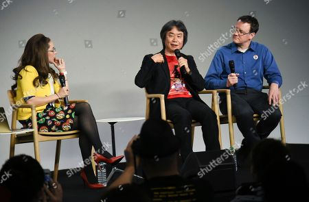 Tech moderator Katie Linendoll, left, Japanese video game designer and producer Shigeru Miyamoto and senior product marketing manager of Nintendo of America and interpreter, Bill Trinen, give a talk at the Apple SoHo store to promote Super Mario Run for iOS, in New York