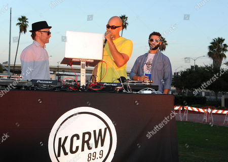 """Stock Image of Chris """"Peanut Butter Wolf"""" Manaks, from left, Garth Trinidad, and Jeff Broadway attend Street Food Cinema featuring Our Vinyl Weighs A Ton: This Is Stone's Throw Records at Exposition Park on in Los Angeles"""