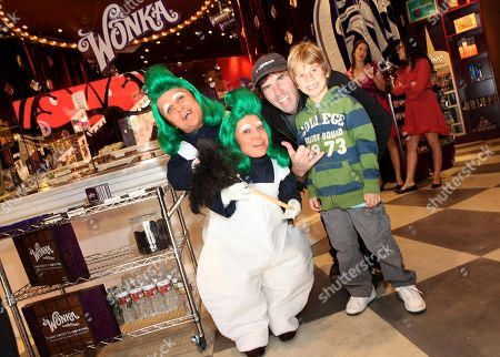 Stock Photo of From third left, Andy MacDonald and Haden MacDonald are seen with Wonka's Oompa Loompas at the new Wonka store at Sweet! Hollywood during the launch of the Wonka Inventing Room Collection, a decadent premium chocolate line,, in Los Angeles