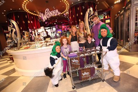 Francesca Capaldi, second left, and Aiden Lovekamp, third from right are seen with Oompa Loompas at the new Wonka store at Sweet! Hollywood during the launch of the Wonka Inventing Room Collection, a decadent premium chocolate line,, in Los Angeles
