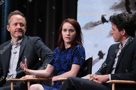 """John Benjamin Hickey, from left, Rachel Brosnahan, and Ashley Zukerman speak onstage during the """"Manhattan"""" panel at the Viacom Networks 2015 Summer TCA Tour held at the Beverly Hilton Hotel, in Beverly Hills, Calif"""