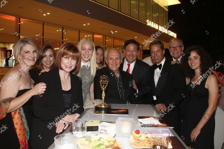 Stephanie Edwards, third from left, winner of the Governor's Award, Sam Rubin, fourth from right, and guests attend the L.A. Area Emmy Awards presented at the Television Academy's new Saban Media Center, in the NoHo Arts District in Los Angeles