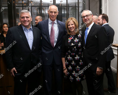 Stock Image of From left, former CEO of Turner Broadcasting, Phil Kent, Comcast president, Neil Smit, Abbe Raven and husband Martin Tackel attend A+E Networks celebration of chairman emeritus Abbe Raven at the Andaz Fifth Avenue, in New York