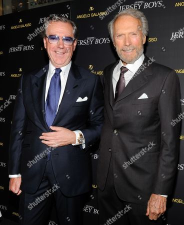 "Italian menswear designer Angelo Galasso, left, poses with director Clint Eastwood at the cocktail reception for a special screening of Clint Eastwood's new film ""Jersey Boys"" at the designer's boutique inside The Plaza on in New York"