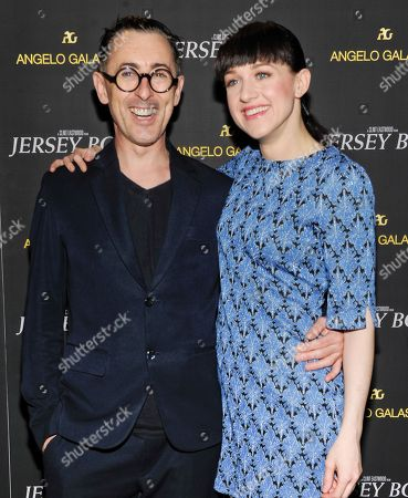 "Actors Alan Cumming and Lena Hall attend a cocktail reception for a special screening of the film ""Jersey Boys"" in the Angelo Galasso boutique inside The Plaza on in New York"