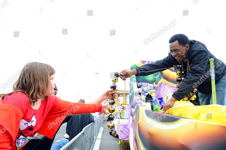 Dwight Henry, star of the Academy Award nominated film Beasts of the Southern Wild, hands out beads in the Argus parade on Mardi Gras on in Metairie, La