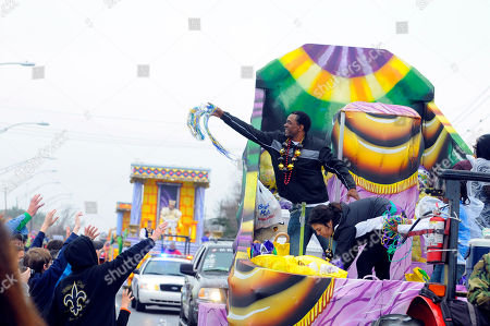 Dwight Henry, star of the Academy Award nominated film Beasts of the Southern Wild, throws beads in the Argus parade on Mardi Gras on in Metairie, La
