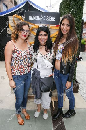 Stock Image of Tiffany Patterson, from left, Rachel Ontiveros and Valerie Cruz wait in line to play Tom Clancy's Rainbow Six Siege at the Ubisoft event during Comic-Con, in San Diego, Calif