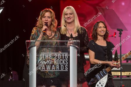 Stock Picture of From left, Vicki Peterson, Debbi Peterson, and Susanna Hoffs of the Bangles during the 2015 She Rocks Awards at the Anaheim Hilton on in Anaheim, Calif