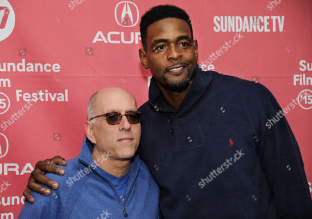 """Stock Image of Peter Gilbert, left, and Chris Webber, executive producers of """"Unexpected,"""" pose together at the premiere of the film at the Library Center Theatre during the 2015 Sundance Film Festival, in Park City, Utah"""