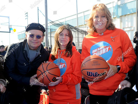 Basketball Hall of Famer and founding partner of DreamCourts, Nancy Lieberman, right, joins Billy and Janice Crystal at the opening ceremony for two new DreamCourts, in Long Beach, N.Y. The courts were constructed and opened today, one-year post Hurricane Sandy, thanks to the Nancy Lieberman Foundation, WorldVentures Foundation and Billy and Janice Crystal