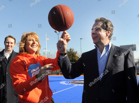 Basketball Hall of Famer and founding partner of DreamCourts, Nancy Lieberman, left, spins a basketball with New York State Governor Andrew Cuomo at the opening ceremony for two new DreamCourts, in Long Beach, N.Y. The courts were constructed and opened today, one-year post Hurricane Sandy, thanks to the Nancy Lieberman Foundation, WorldVentures Foundation and Billy and Janice Crystal