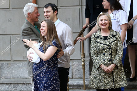 Stock Picture of Bill Clinton, from left, Marc Mezvinsky, Chelsea Clinton with newborn son, Aidan Clinton Mezvinsky and Hillary Clinton leave Lenox Hill Hospital, in New York