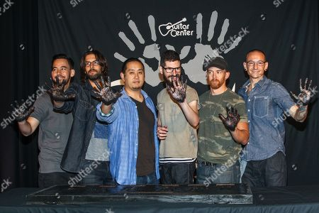 Linkin Park (From left, Mike Shinoda, Rob Bourdon, Joe Hahn, Brad Delson, Dave 'Phoenix' Farrell and Chester Bennington) attend Linkin Park's induction into the Guitar Center's RockWalk at Guitar Center on in Hollywood, California