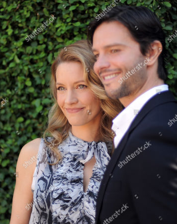 KaDee Strickland, left and Jason Behr arrive at the Rape Treatment Center fundraiser at Greenacres, the private residence of Ron Burkle,, in Beverly Hills, Calif