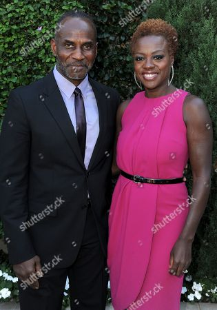Viola Davis, right, and Julius Tennon arrive at the Rape Treatment Center fundraiser at Greenacres, the private residence of Ron Burkle,, in Beverly Hills, Calif