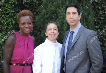 From left, Viola Davis, The Rape Foundation President Gail Abarbanel and David Schwimmer arrive at the Rape Treatment Center fundraiser at Greenacres, the private residence of Ron Burkle,, in Beverly Hills, Calif