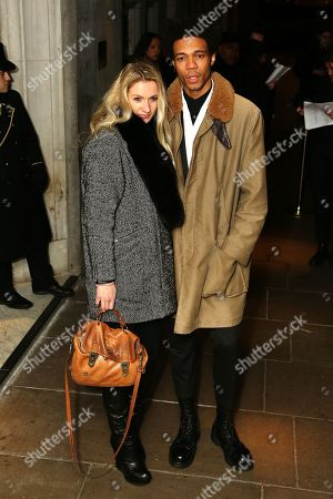Joe Casely-Hayford and guest arrives at the The BRIT Awards 2013 - Warner Music & Vanity Fair Afterparty at The Savoy Hotel, in London