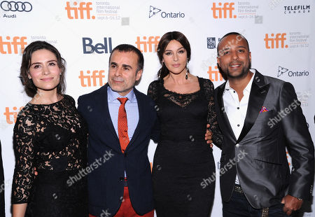 "From left, actress Belçim Bilgin, director/writer/producer Bahman Ghobadi, actress Monica Bellucci and actor Arash Labaf arrive at the premiere for ""Rhino Season"" during the Toronto International Film Festival on in Toronto"