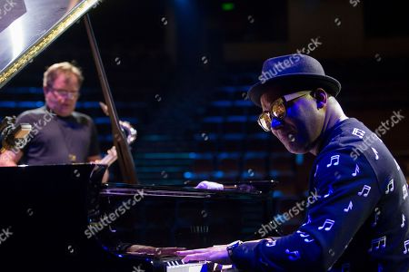 Gonzalo Rubalcaba, Igor Butman. Cuban piano player Gonzalo Rubalcaba, right, and Russian jazz saxophonist Igor Butman perform during a soundcheck before a concert in Moscow, Russia, on Thursday, Nov., 9, 2017