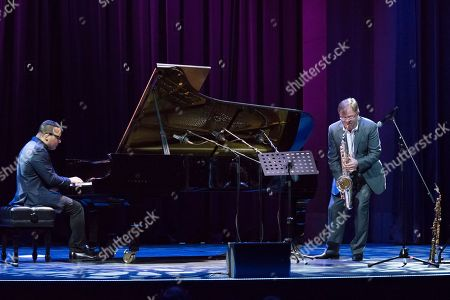 Stock Photo of Igor Butman, Gonzalo Rubalcaba. Russian jazz saxophonist Igor Butman, right, and Cuban piano player Gonzalo Rubalcaba perform during a soundcheck before a concert in Moscow, Russia, on Thursday, Nov., 9, 2017