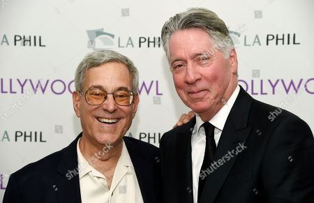 """Bob Gale, left, producer and co-writer of the 1985 film """"Back to the Future,"""" poses with the film's composer Alan Silvestri backstage before the """"Back to the Future - In Concert 30th Anniversary"""" event at the Hollywood Bowl, in Los Angeles"""