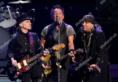 Bruce Springsteen, center, performs with Nils Lofgren, left, and Steven Van Zandt of the E Street Band during their concert at the Los Angeles Sports Arena in Los Angeles. Bruce Springsteen and the E Street Band just don't want to leave the stage. The concert, at Citizens Bank Park in Philadelphia lasted nearly four hours, four minutes, breaking the previous record for the group's longest U.S. show set last week