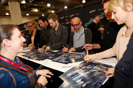"""Stock Picture of From left, Connie Nielsen, James Purefoy, Shawn Ashmore, Marcos Siega, Kevin Williamson, Kevin Bacon, and Valorie Curry participate in FOX's """"The Following"""" autograph signing and panel during New York Comic Con, on at Javits Convention Center, in New York City, NY"""